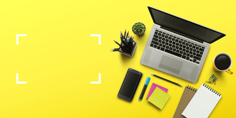 Office workplace with laptop, notebook, office supplies and stationery on yellow background. Solution, business planning, creative, design, learning, start up or working flat lay top view concept. Wall mural