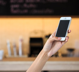 Close Up Of hand Woman Using Mobile Phone In cafe