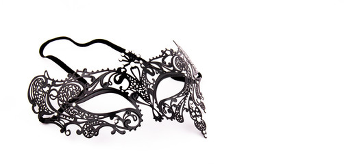Black delicate lace mask on a white background. Black metal carnival mask. Copy space