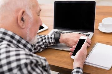 Senior man using smartphone mockup
