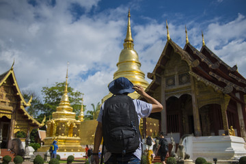 Man tourist is visiting at Wat Phra Singh in Chiangmai, Thailand.