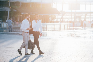 two bearded business men young outdoor back light walking chatting - business, relaxing concept