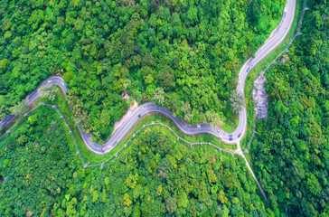 aerial view,Top view,amazing nature background.Winding road on the mountain.And the car ran.A beautiful view.thailand