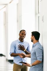 Workspace: Business Friends Handshake In Hallway