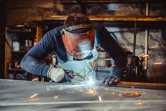 Man with safety glasses welding