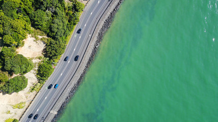 Aerial view on a road running along sea shore. Auckland, New Zealand.