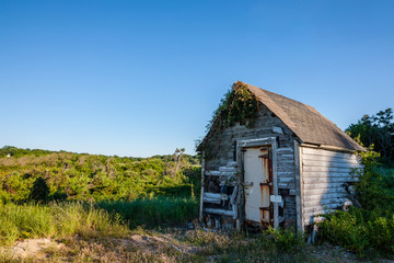 old shack next to countryside