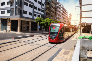 a tram passing on the railway in a sunny day - Casablanca - Morocco