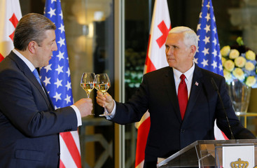 U.S. Vice President Mike Pence toasts with Georgian Prime Minister Georgy Kvirikashvili during an official dinner in Tbilisi