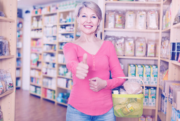 Mature shopper showing purchased healthy food