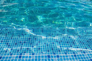 Beautiful pattern of blue water reflecting sun.