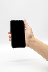 Female hand holding black mobile phone with black screen