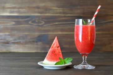 Watermelon drink on wooden background
