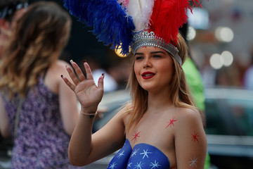 A so called Desnuda, a woman with painted naked body parts that poses for photos for tips is pictured in Times Square in New York City