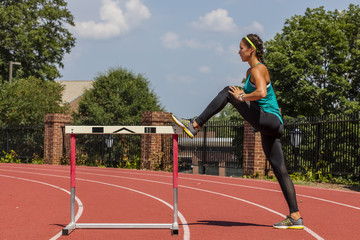 A brunette model working out in an outdoor environment