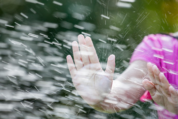 Hands of child girl  playing water splash in outside