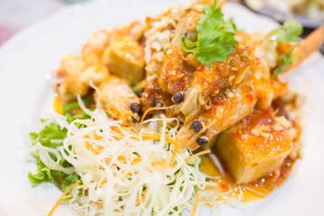 Fried prawns on a plate, Thai seafood.