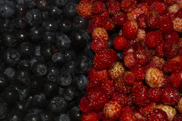 Background of strawberries and blueberries in half