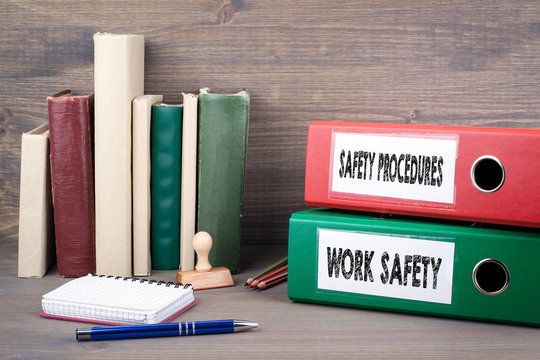 Work Safety and Safety Procedures. Binders on desk in the office. Business background.