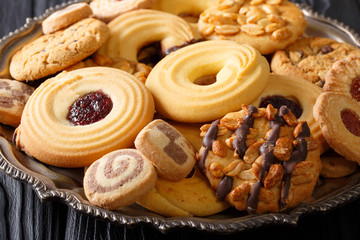 Poster Koekjes Cookie mix with nuts, chocolate, jelly closeup, horizontal