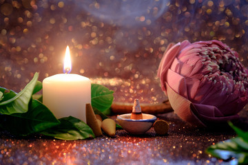 Pink lotus flower folding thai style with white candle light and incense thai aroma stick  with red bokeh background for pray or meditation caption and aroma concept