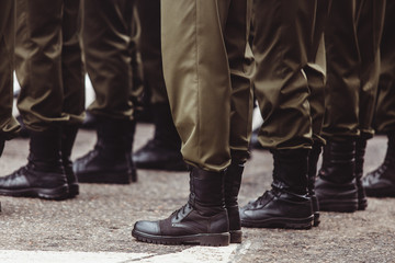 military men in green dress uniform stand at attention