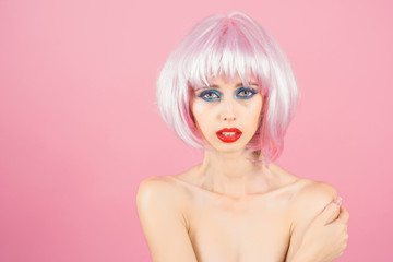 woman with pink hair wig and fashionable makeup