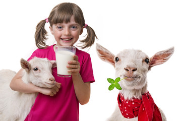 little girl drinking healthy goat milk isolated on white background