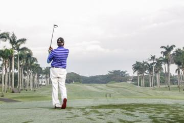 senior enjoying  Golfing