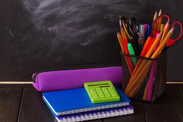 Multicolor pencils with black chalkboard
