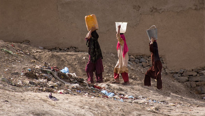 Women carrying water in Kabul, Afghanistan