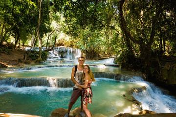 Couple on Kuang Si waterfall
