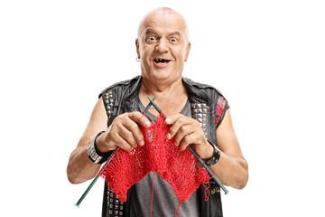 Elderly punker knitting and smiling
