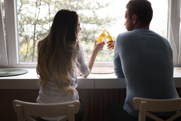 Happy romantic couple in love celebrating and toasting at home