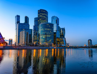 Skyscrapers of Moscow City business center and Moscow river in Moscow at night, Russia