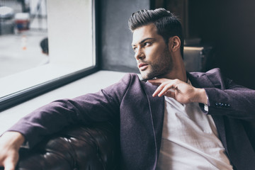 handsome man with fashionable hairstyle - fototapety na wymiar