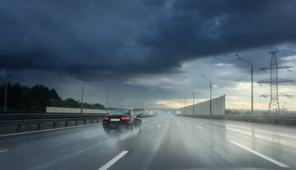 Seeing as there's heavy shower on a highway and road condition looks quite dangerous.