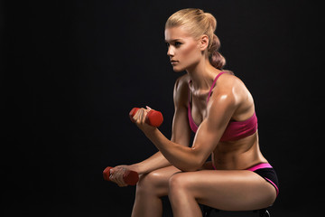 beautiful fitness woman with dumbbells