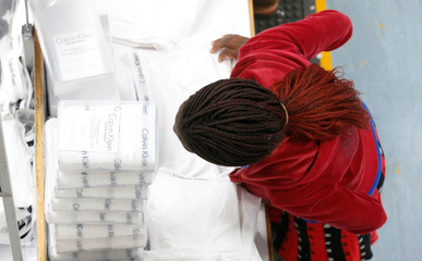 A Kenyan worker arranges men's underwear at the Hela intimates export processing zone limited factory in Athi River, near Nairobi