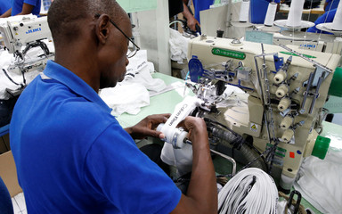 A Kenyan worker prepare men's underwear at the Hela intimates export processing zone limited factory in Athi River, near Nairobi