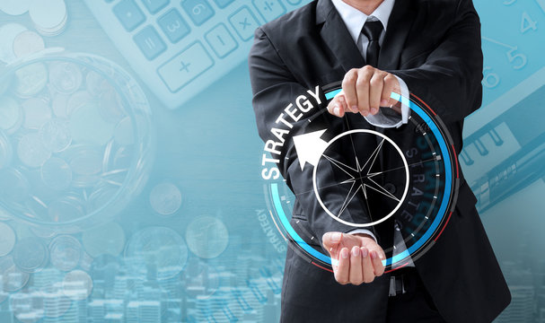 business man drive compass to strategy