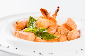 Risotto with shrimp and salmon in a mild creamy sauce (close)