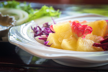 Closeup fruits salad on white ceramic bowl, Fruits salad for eating healthy and dieting
