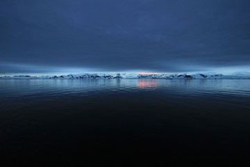 Antarctica landscape, icebergs, mountains and ocean at sunrise, Antarctica Wall mural