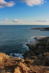 Sunset litting the sea and seacoast