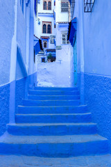Street and building at Chefchaouen, the blue city in the Morocco. Old traditional town. Travel destination concept. Architectural decoration and design details.