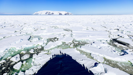 Shadow of ship on ice floe in East Antarctica