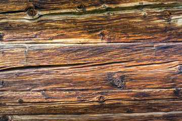 detailed view of horizontal old wooden boards on a cabin wall as a rustic background