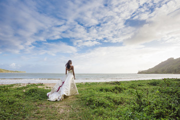 Portrait of bride at coastline of Kahana Bay