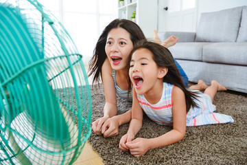 selective focus photo of woman and little girl